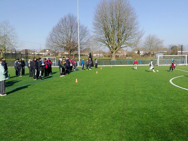 A large crowd of coaches learn new goalkeeper training drills and techniques